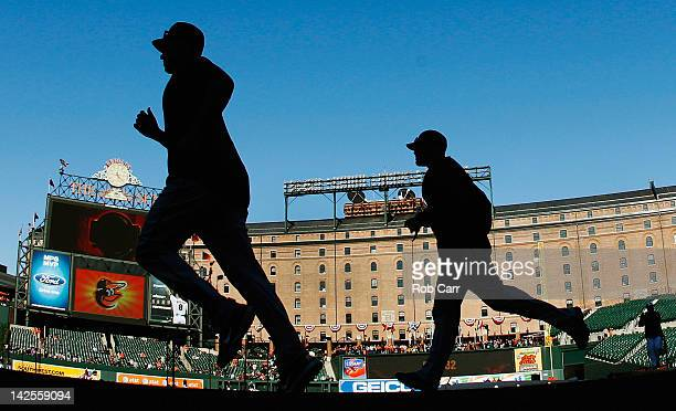 Members of the Minnesota Twins warm up before the start of their game against the Baltimore Orioles at Oriole Park at Camden Yards on April 7 2012 in...