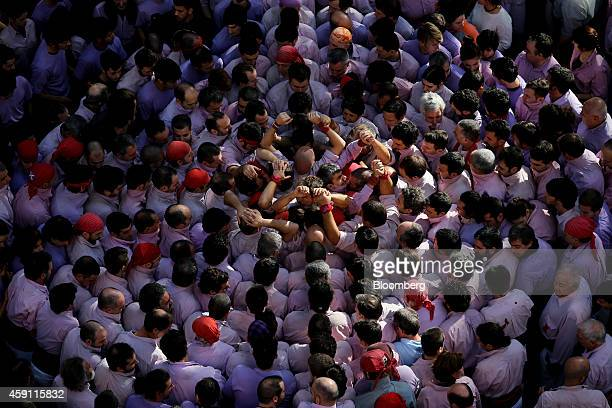 Members of the Minyons de Terrassa stand closely packed together as they prepare to form the base of a traditional Catalan human tower in the...