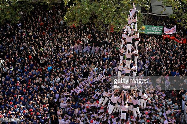 Members of the Minyons de Terrassa stand on each other's shoulders as they form a traditional Catalan human tower in the Terrassa province of...