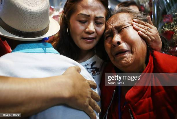 Members of the Miraflores and Linares families hug while reuniting at a reunification event for Mexican families separated from loved ones living in...