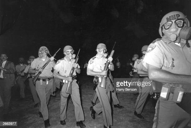 Members of the Mississippi Highway Patrol move in on the town of Canton to tear gas participants on the Meredith Mississippi March June 1966 The...