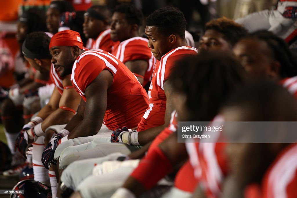 Members of the Mississippi Rebels watch the last few minutes of a 10-7 loss to LSU Tigers at Tiger Stadium on October 25, 2014 in Baton Rouge, Louisiana.