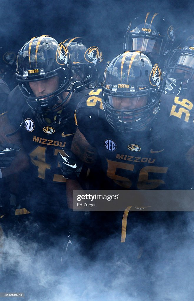 Members of the Missouri Tigers make their way onto the field prior to a game against the South Dakota State Jackrabbits in the quarter at Memorial Stadium on August 30, 2014 in Columbia, Missouri.