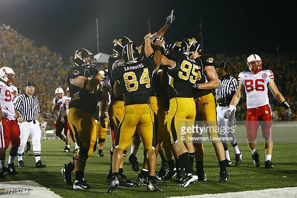 Members of the Missouri Tigers mob Martin Rucker following a touchdown against the Nebraska Cornhuskers during 2nd-half action on October 6, 2007 at...