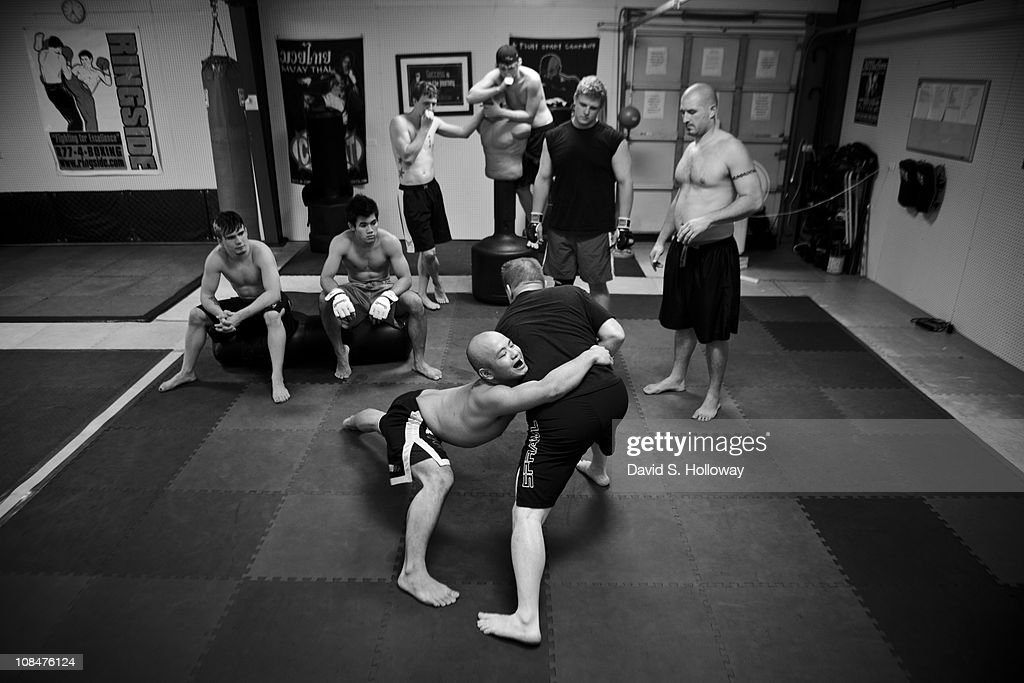Members of the MMA Team Ronin Fight Club watch instructor Rodney Hitchcock at Hitchcock Martial Arts in Waldron, Arkansas on August 11, 2010. Though the small school is in a relatively remote town, it has produced several fighters who have been successful on a regional level.