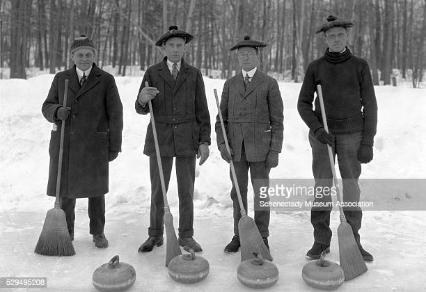 Members of the Mohawk Golf Club Curling Team pose with their brooms and stones This curling team won the WF Allen Medal at Utica on February 11 1920...