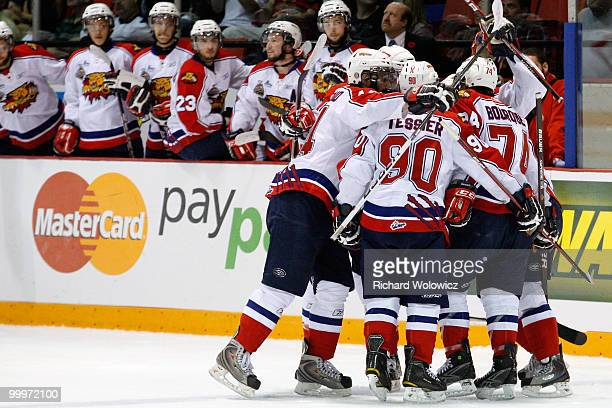 Members of the Moncton Wildcats celebrate the first period goal by Gabriel Bourque during the 2010 Mastercard Memorial Cup Tournament against the...