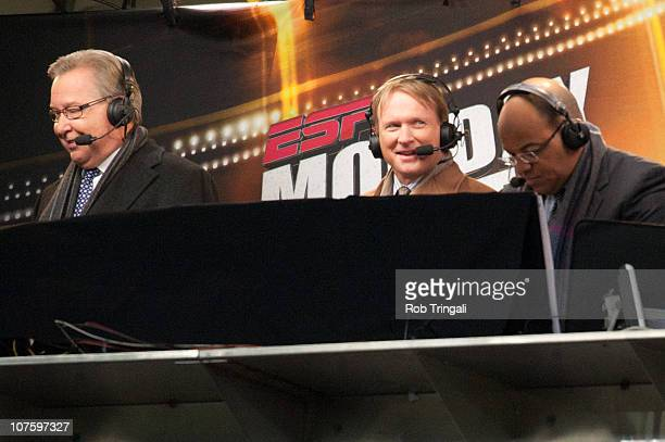 Members of the Monday Night announcing crew Ron Jaworski John Gruden and Mike Tirico of ESPN look on during the game between the New England Patriots...
