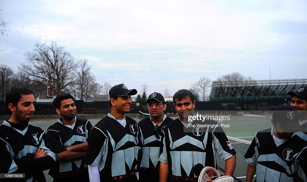 Members Of The Montgomery College Cricket Team Gather In A