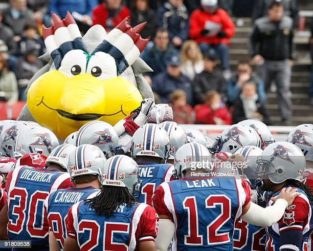 Members of the Montreal Alouettes huddle prior to facing the Calgary Stampeders at Percival Molson Stadium on October 12 2009 in Montreal Quebec...