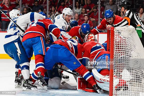 Members of the Montreal Canadiens and Tampa Bay Lightning battle for the puck in front of goaltender Carey Price in Game Two of the Eastern...
