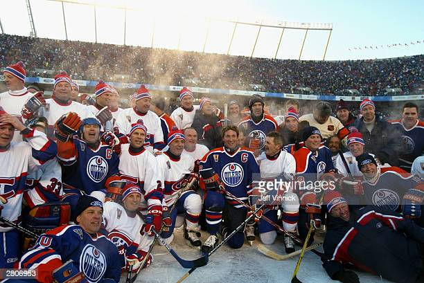 Members of the Montreal Canadiens and the Edmonton Oilers gather for a group photo after the Molson Canadien Heritage Classic Megastars Game on...