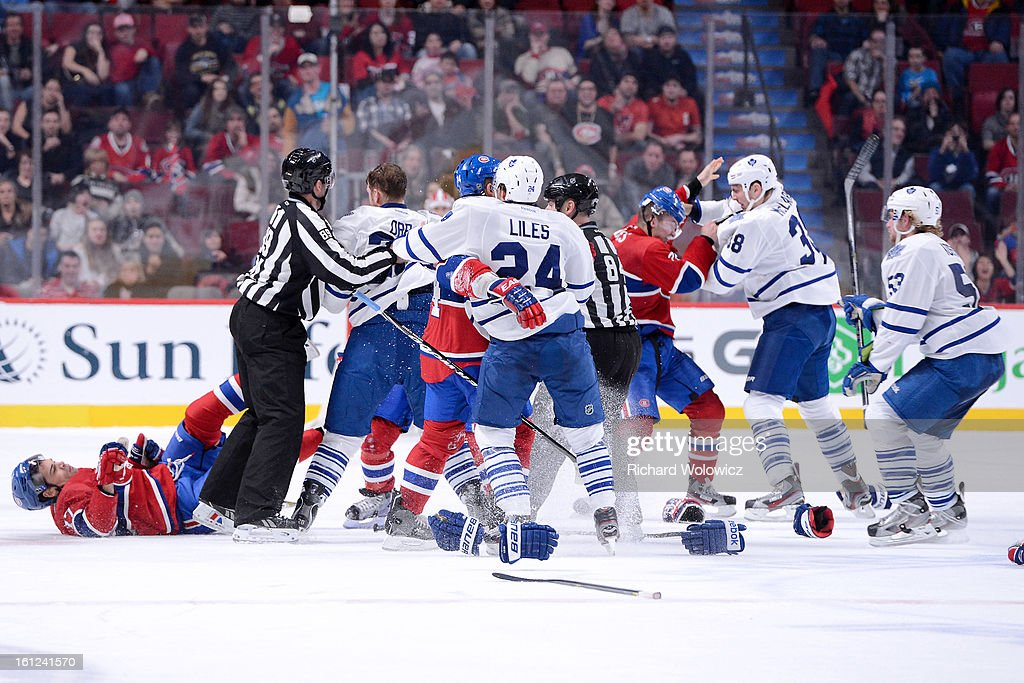 Members of the Montreal Canadiens and Toronto Maple Leafs mix it up during the NHL game at the Bell Centre on February 9, 2013 in Montreal, Quebec, Canada. The Maple Leafs defeated the Canadiens 6-0.