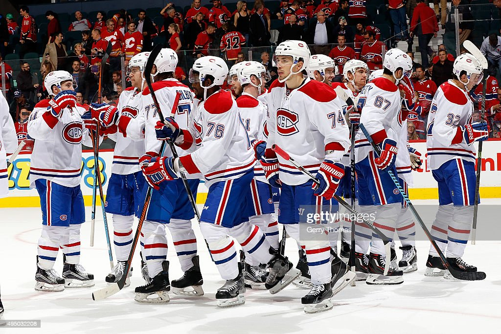 Members of the Montreal Canadiens celebrate a 6-2 win over the Calgary Flames after an NHL game at Scotiabank Saddledome on October 30, 2015 in Calgary, Alberta, Canada.