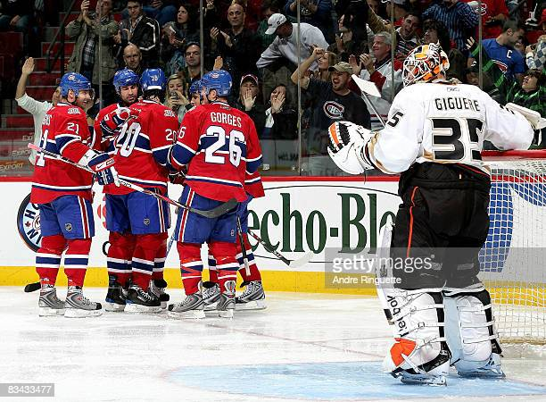 Members of the Montreal Canadiens celebrate a second period goal against JeanSebastien Giguere of the Anaheim Ducks at the Bell Centre on October 25...
