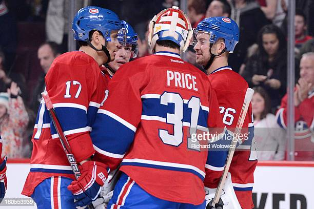 Members of the Montreal Canadiens celebrate after defeating the Buffalo Sabres in their NHL game at the Bell Centre on February 2 2013 in Montreal...