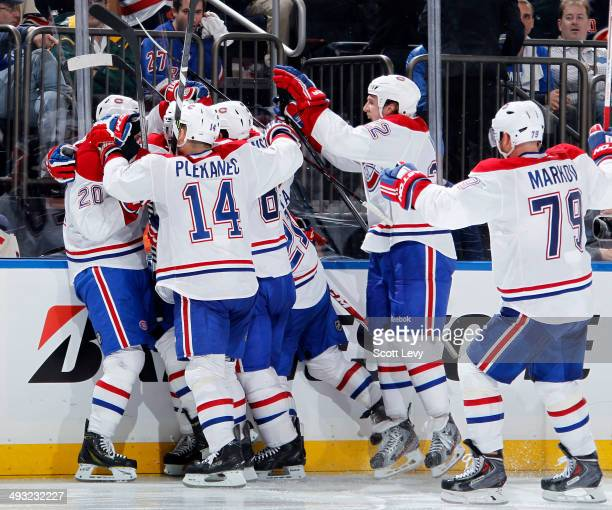 Members of the Montreal Canadiens celebrate the game winning goal by Alex Galchenyuk in the overtime period of Game Three of the Eastern Conference...
