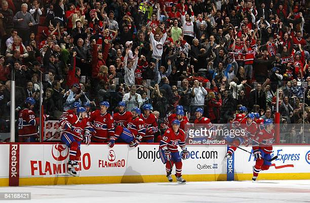 Members of the Montreal Canadiens celebrate their shootout win over the Florida Panthers during their NHL game at the Bell Centre January 4 2009 in...