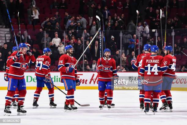 Members of the Montreal Canadiens raise their sticks in the air to acknowledge the fans after defeating the New York Rangers during the NHL game at...