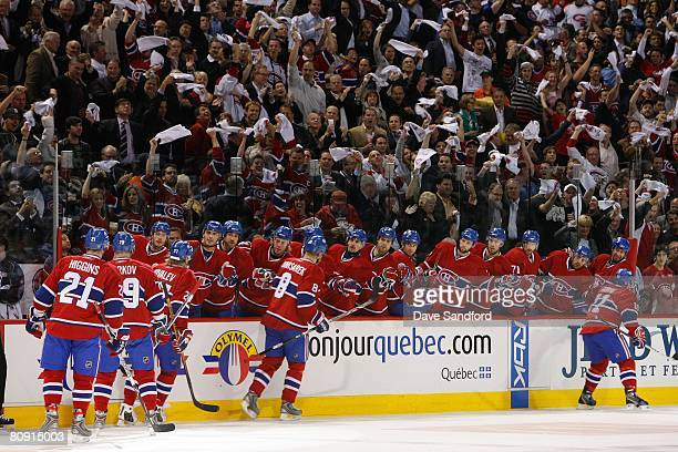 Members of the Montreal Canadiens skate by the bench area to celebrate after a play during game seven of the 2008 NHL Eastern Conference...
