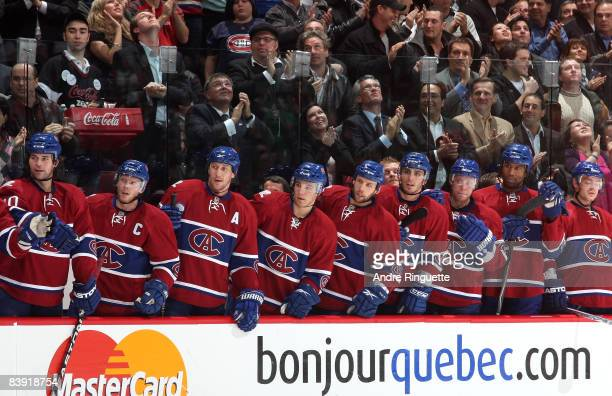 Members of the Montreal Canadiens wait at the bench tro celebrate a first period goal against the New York Rangers wearing vintage jerseys on a night...