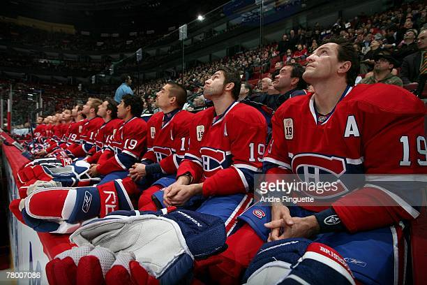 Members of the Montreal Canadiens watch a video on the scoreboard during Larry Robinson's jersey retirement ceremony before a game against the Ottawa...