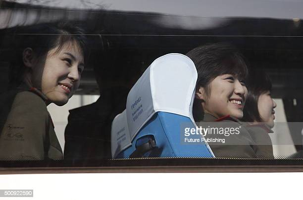Members of the Moranbong Band leave their hotel for a rehearsal on December 11 2015 in Beijing China The Moranbong band will perform in the National...
