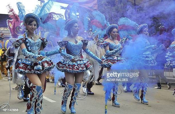 Members of the Morenada Central Cocanis de Oruro brotherhood take part in Carnival of Oruro in the mining town of Oruro 240 km south of La Paz on...