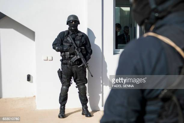 Members of the Moroccan antiterrorism security service stand guard outside a building at the Central Bureau of Judicial Investigation in Sale near...