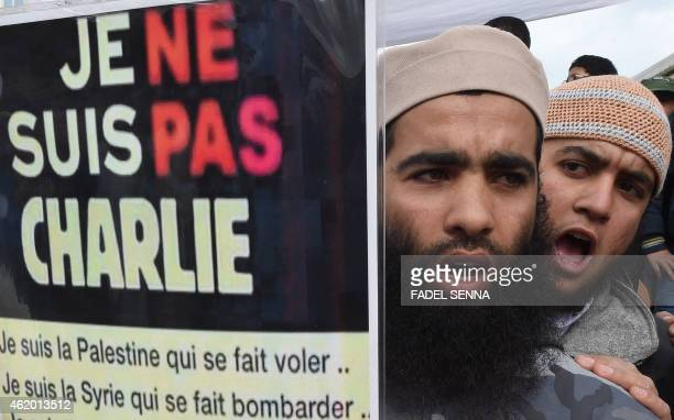 Members of the Moroccan Salafist movement shout slogans as they hold placards during a protest on January 23 2015 in the coastal town of Sale against...