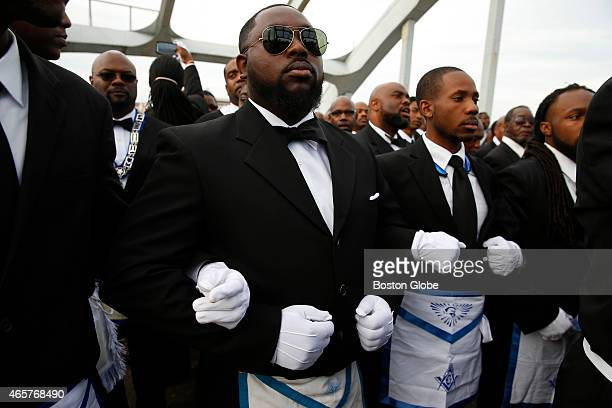 Members of the Most Worshipful Prince Hall Grand Lodge link arms as they retrace the steps of those who marched with Dr Martin Luther King Jr over...