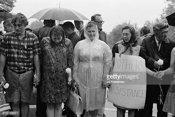 Members of the Mothers' Draft Resistance helping to burn draft cards in Washington DC during an antiVietnam War and antidraft protest 1968