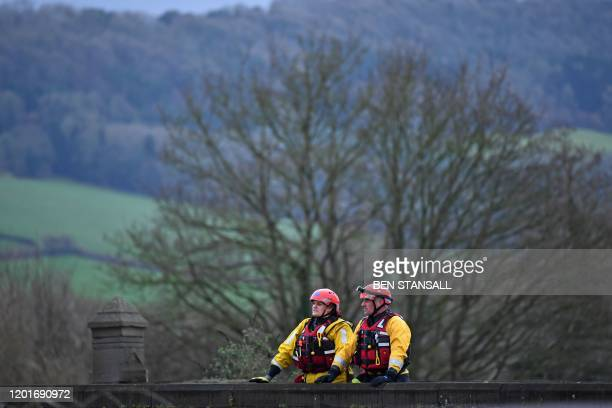 Members of the Mountain Rescue division arrive to assist with the rescue of residents in Monmouth south Wales on February 18 after Storm Dennis...