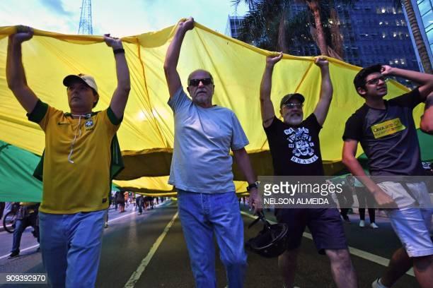 Members of the Movement Vem Pra Rua demonstrate against former President Luiz Inacio Lula da Silva outside the Federal Regional Court building in Sao...