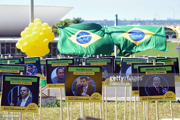 Members of the Movement Vem Pra Rua set up boards depicting congressists against and in favour of the impeachment of President Dilma Rousseff, in...