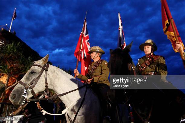 Members of the Mudgeeraba light horse troop take part in an ANZAC Dawn service at Currumbin Surf Life Saving Club on April 25 2012 in Gold Coast...