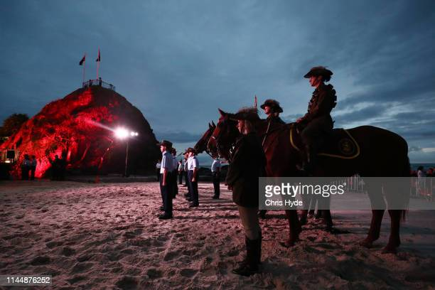 Members of the Mudgeeraba light horse troop take part in the ANZAC dawn service on April 25, 2018 in Currumbin, Australia. Australians commemorating...