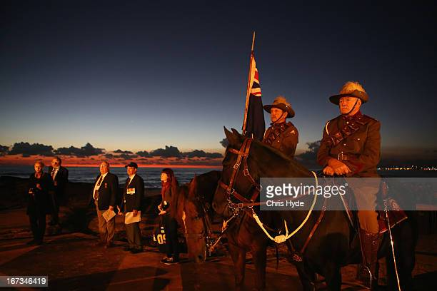 Members of the Mudgeeraba light horse troop take part in the ANZAC dawn service at Currumbin Surf Life Saving Club on April 25, 2013 in Gold Coast,...
