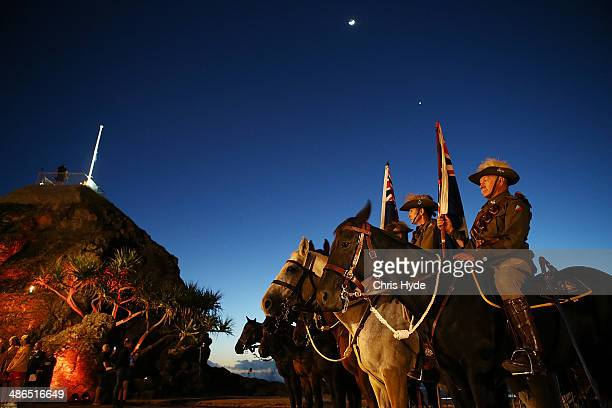 Members of the Mudgeeraba light horse troop take part in the ANZAC dawn service at Currumbin Surf Life Saving Club on April 25 2014 in Gold Coast...
