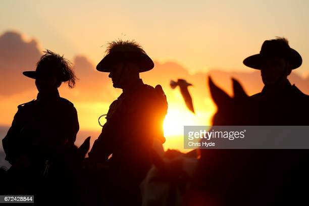 Members of the Mudgeeraba light horse troop take part in the ANZAC dawn service at Currumbin Surf Life Saving Club on April 25 2017 in Currumbin...
