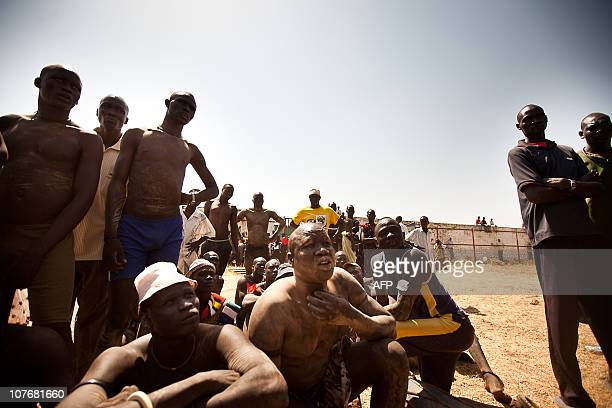 Members of the Mundari tribe from Central Equatoria attend the final of Sudan's first commercial wrestling league between the Mundari tribe and the...