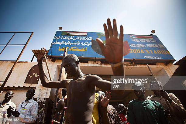Members of the Mundari tribe from Central Equatoria leave the stadium following the final of Sudan's first commercial wrestling league between their...