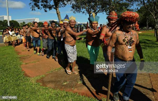 Members of the Munduruku tribe leave the Acampamento Terra Livre in Brasilia to protest in front of the Justice Ministry against a proposed dam on...