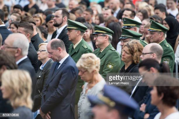 Members of the Munich Police attend an event to commemorate the first anniversary of the shooting spree that one year ago left ten people dead...