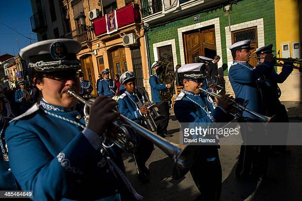 Members of the music band of the 'Santisimo Cristo del Salvador' brotherhood perfom on their way to the beach during a holy week procession on April...