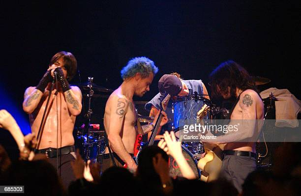 Members of the music group the Red Hot Chilli Peppers perform on stage June 10 2002 at Circulo Bellas Artes in Madrid Spain