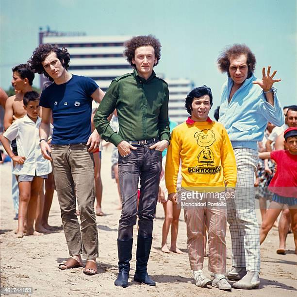 Members of the musical group Equipe 84 at the beach from the left Franco Ceccarelli Maurizio Vandelli Alfio Cantarella and Victor Sogliani Italy 1966