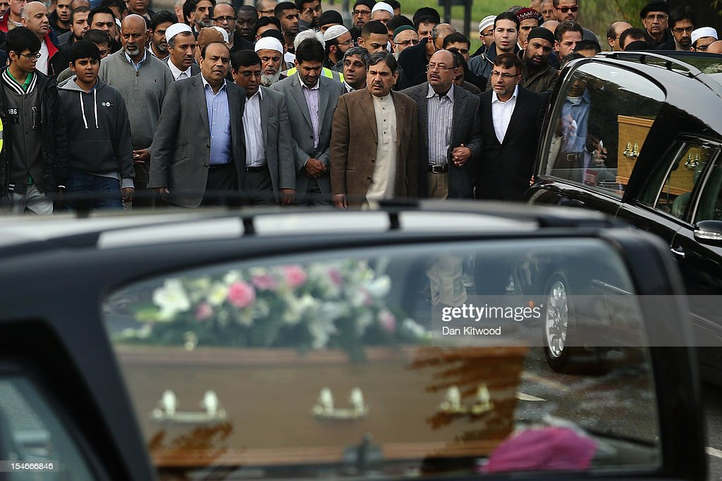 Members of the Muslim Community and friends and family of Sabah Usmani and her five children, who were killed in a house fire, follow the funeral cortege to the crematorium after a service of prayer on October 24, 2012 in Harlow, England. Dr Sabah Usmani and her sons Sohaib, 11, and Rayyan, 6, and daughter Hira, 13, died in a house fire in Harlow on October 15. Her other son, Muneeb, 9, and daughter Maheen, 3, both died later in hospital. Her husband Dr Abdul Shakoor, who was released from hospital last week, lead the funeral at Harlow Islamic Centre, which was attended by some 200 mourners.