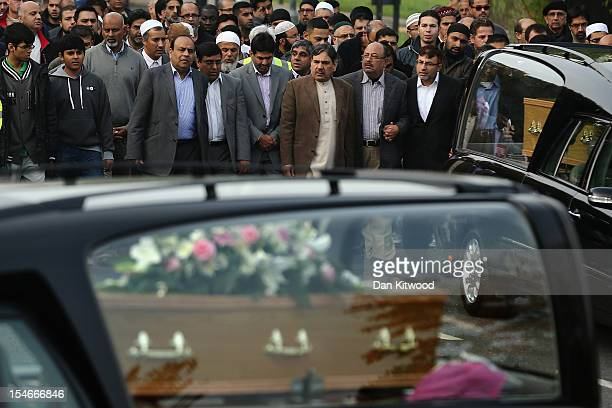 Members of the Muslim Community and friends and family of Sabah Usmani and her five children who were killed in a house fire follow the funeral...