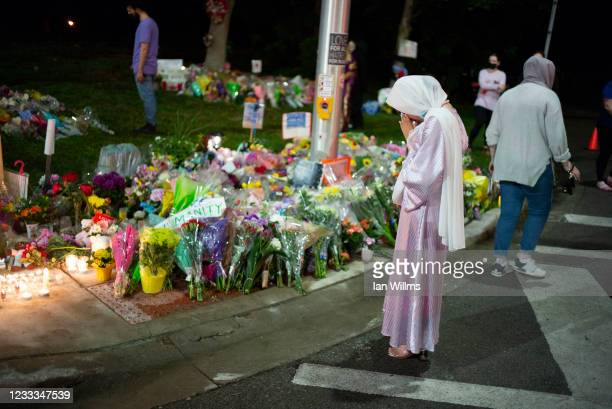 Members of the Muslim community and supporters light candles and place flowers at a memorial on June 8, 2021 in London, Canada. A vigil was held...